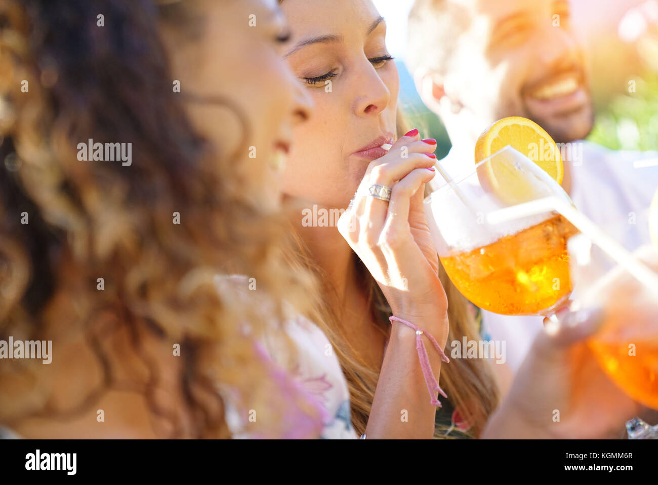 Portrait of girlfriends having fun at summer party - Stock Image