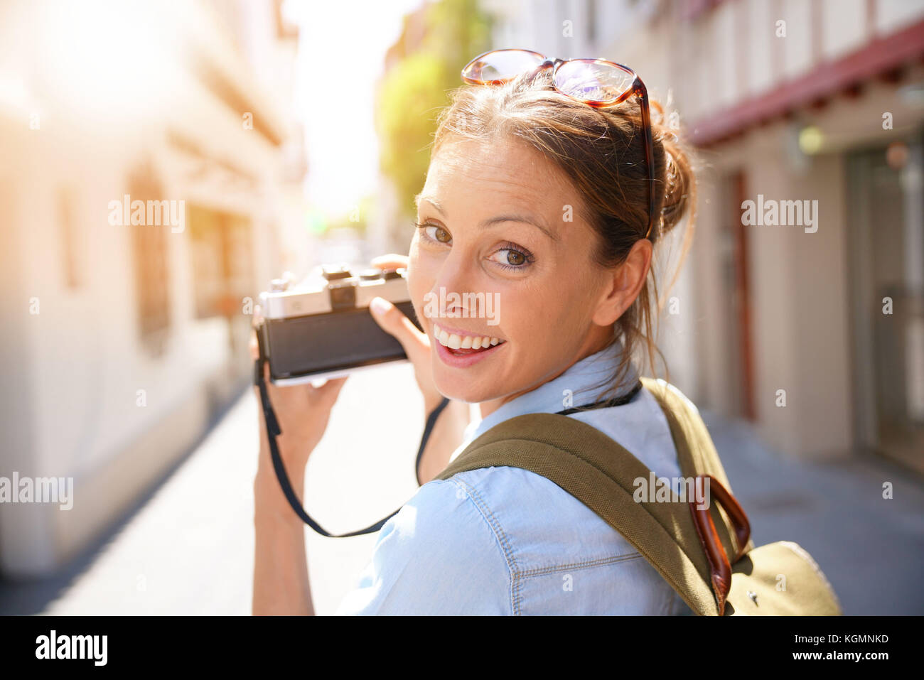 Portrait of tourist taking picture of architectural details - Stock Image