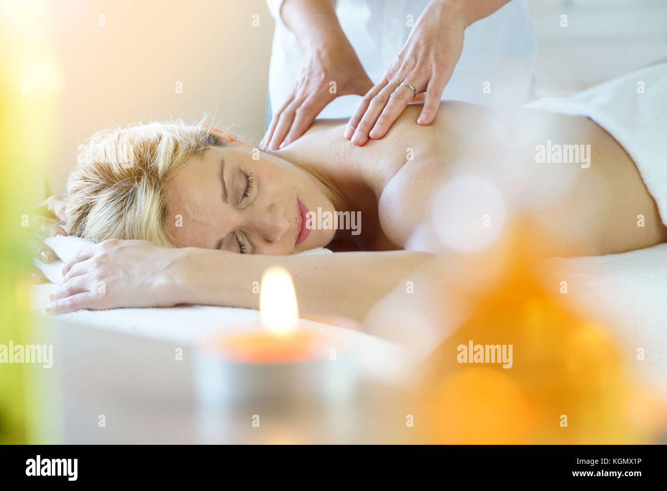 Woman laying on massage table - Stock Image