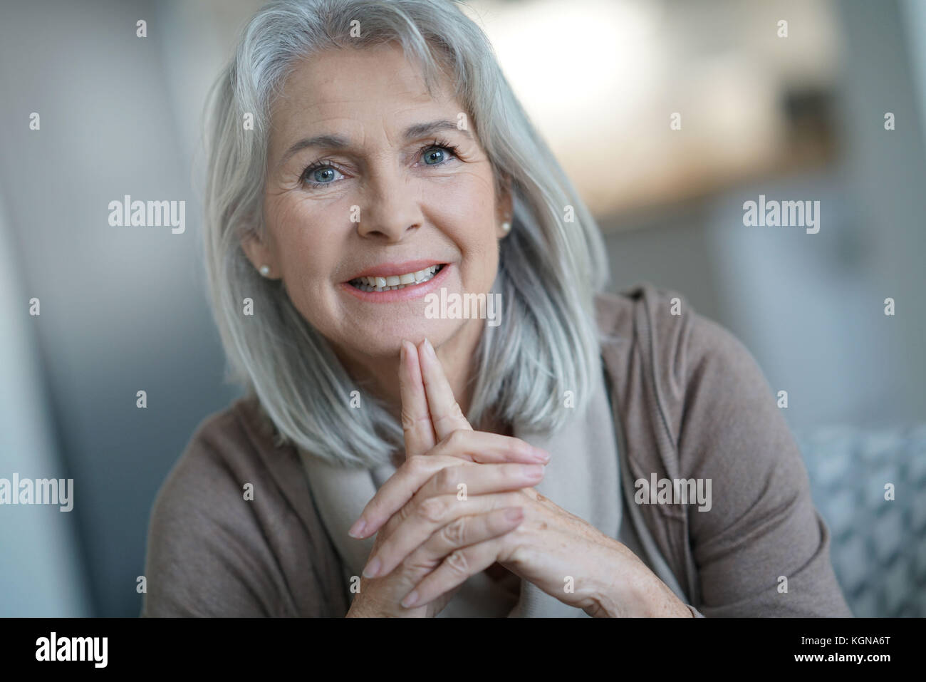 Portrait of beautiful senior woman with white hair - Stock Image