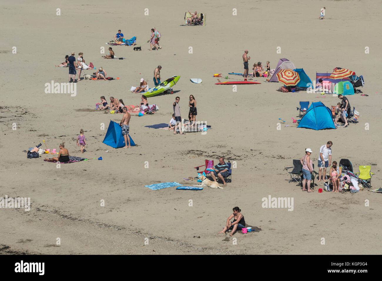 Wide shot of the holidaymakers on a Cornish beach on a sunny august bank holiday. - Stock Image