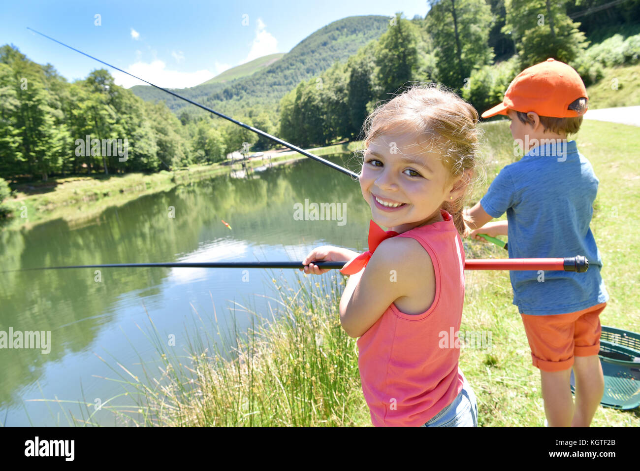 Blond girl fishing stock photos blond girl fishing stock for Little girl fishing pole