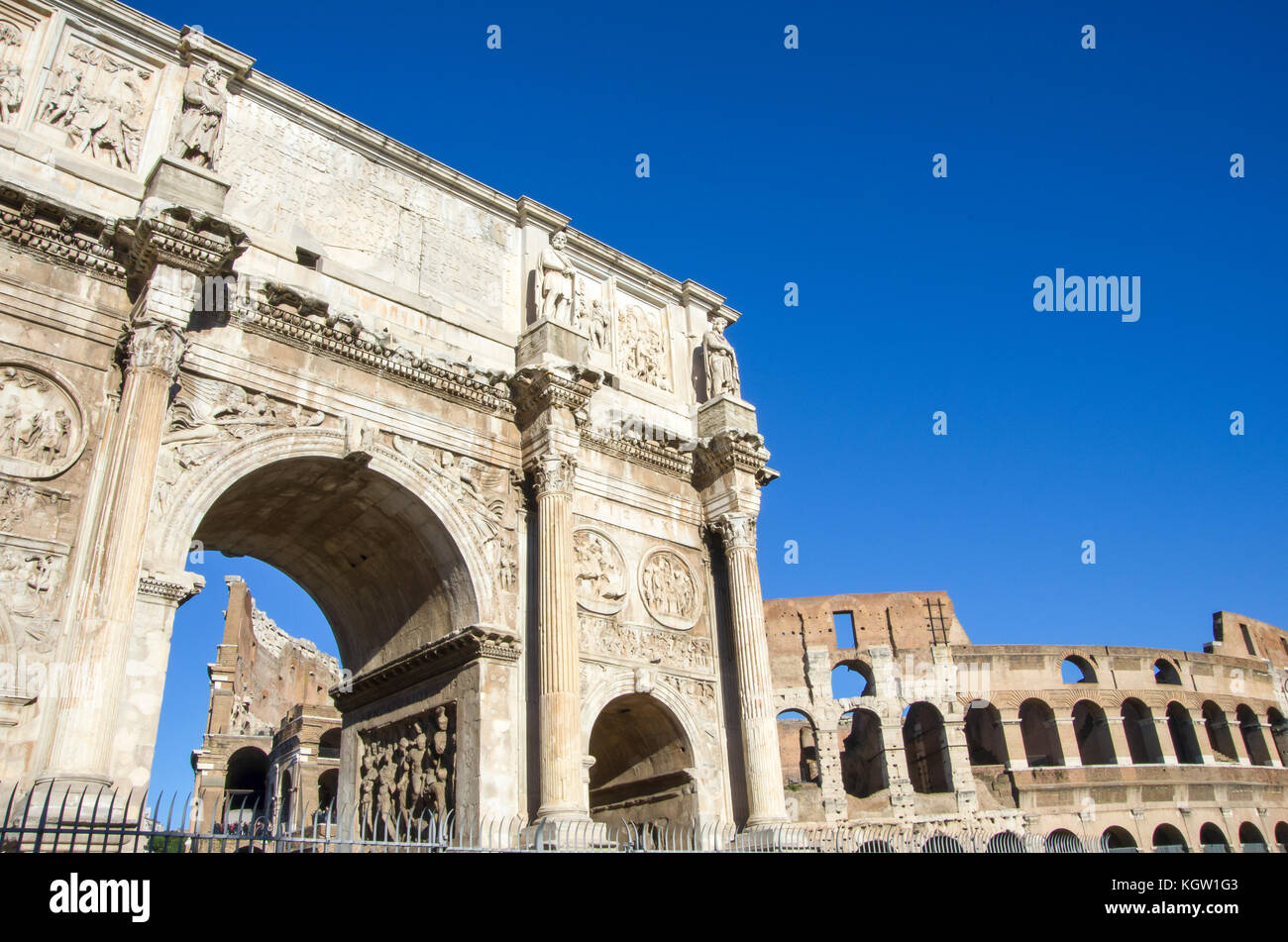 Arch of Constantine with Colosseum in the background - Stock Image