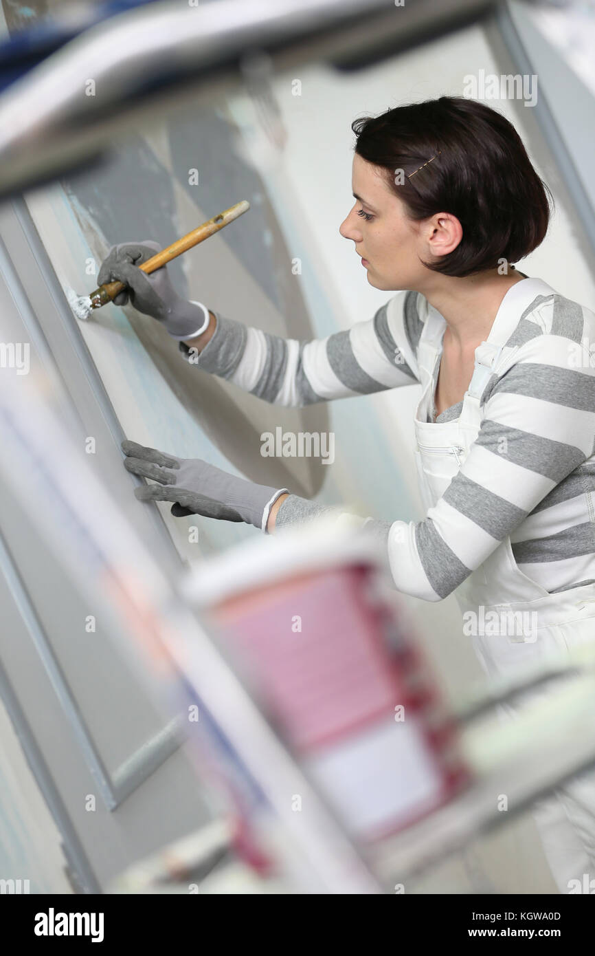 Young woman in professional school to become painter - Stock Image