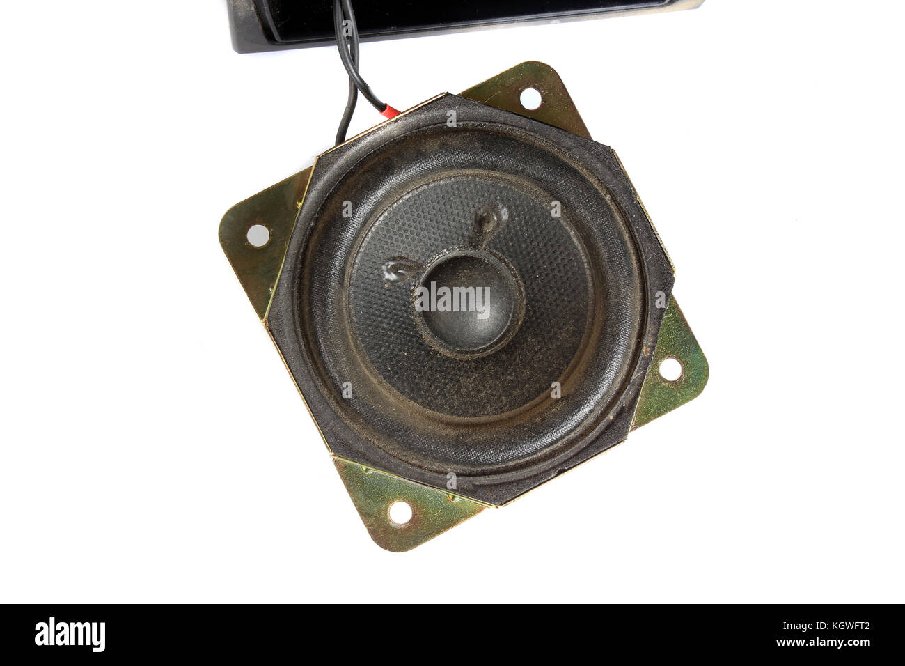 The woofer inside an old computer speaker made of fibre and metal. - Stock Image