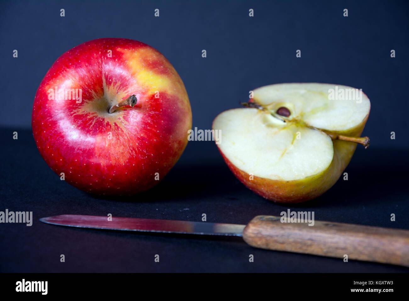 Apple tree leaf half cutted apple and whole apple
