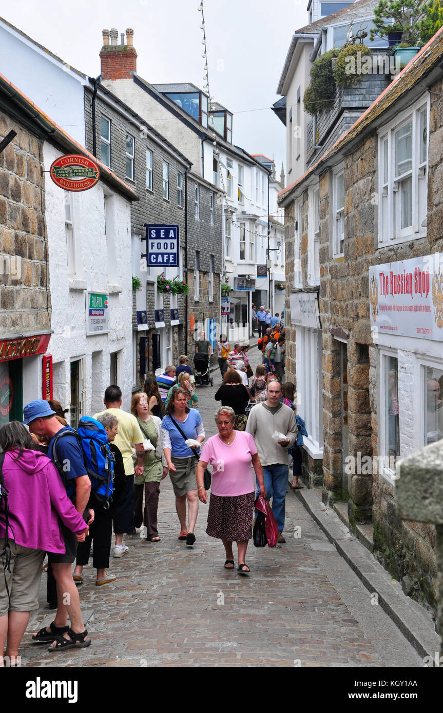 A busy  narrow back street in St Ives Cornwall.Suitable for pedestrians only it becomes very congested - Stock Image