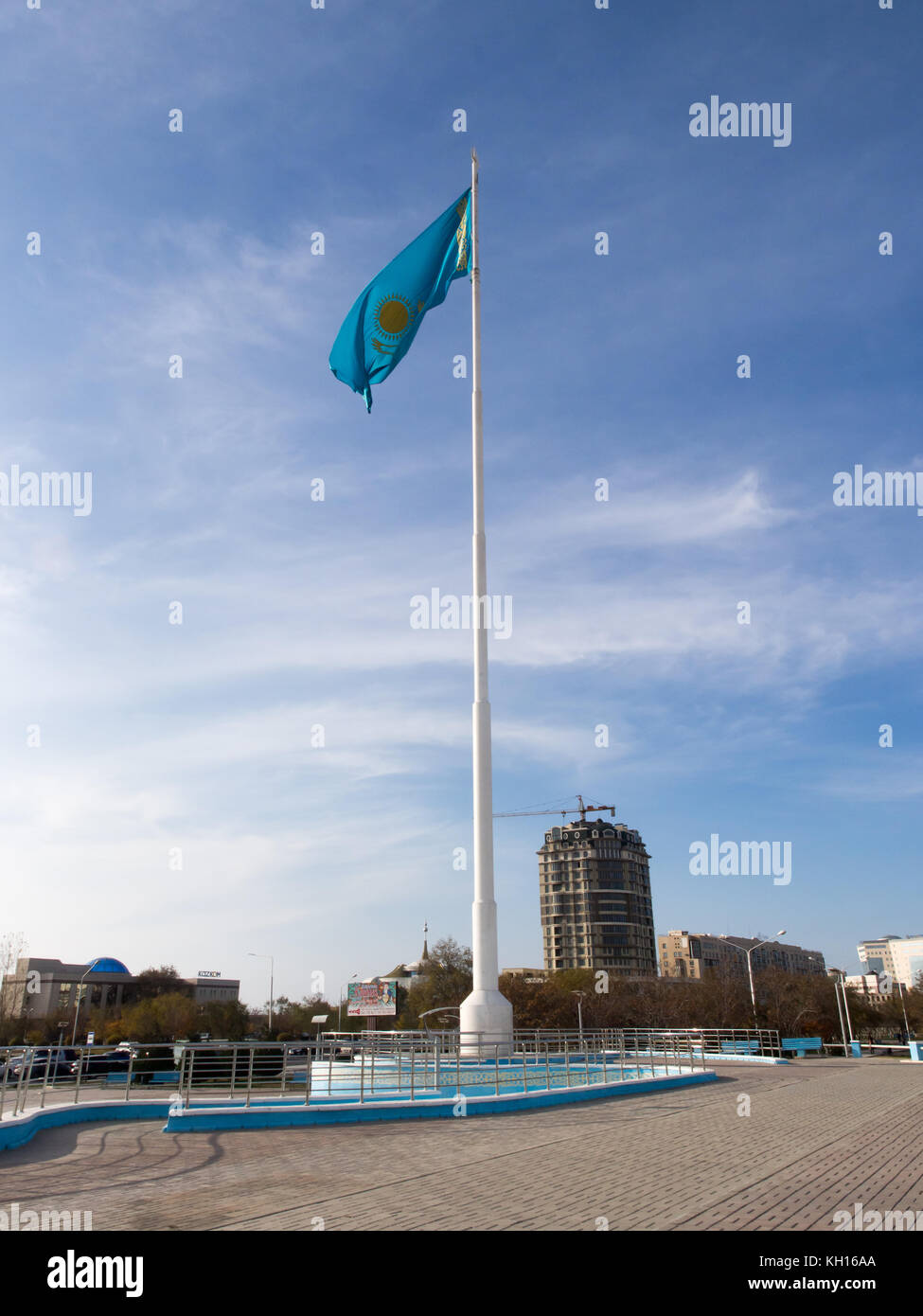 Business Kazakhstan, Flag of Kazakhstan Against a Blue Sky in the Wind, Blue Flag of Kazakhstan, Aktau Kazakhstan, - Stock Image