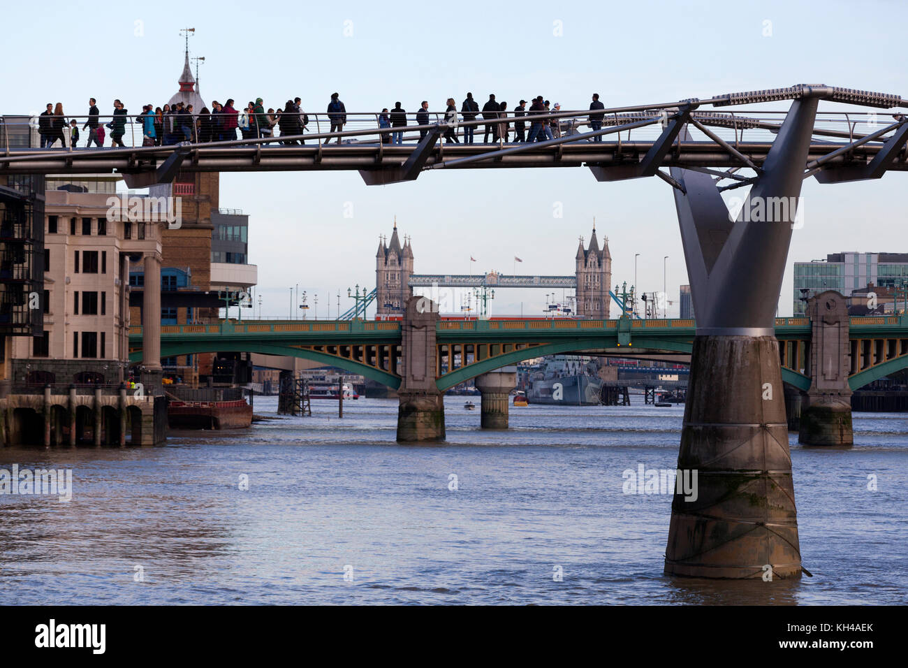Millennium Bridge over the Thames with Tower Bridge in the background, London - Stock Image