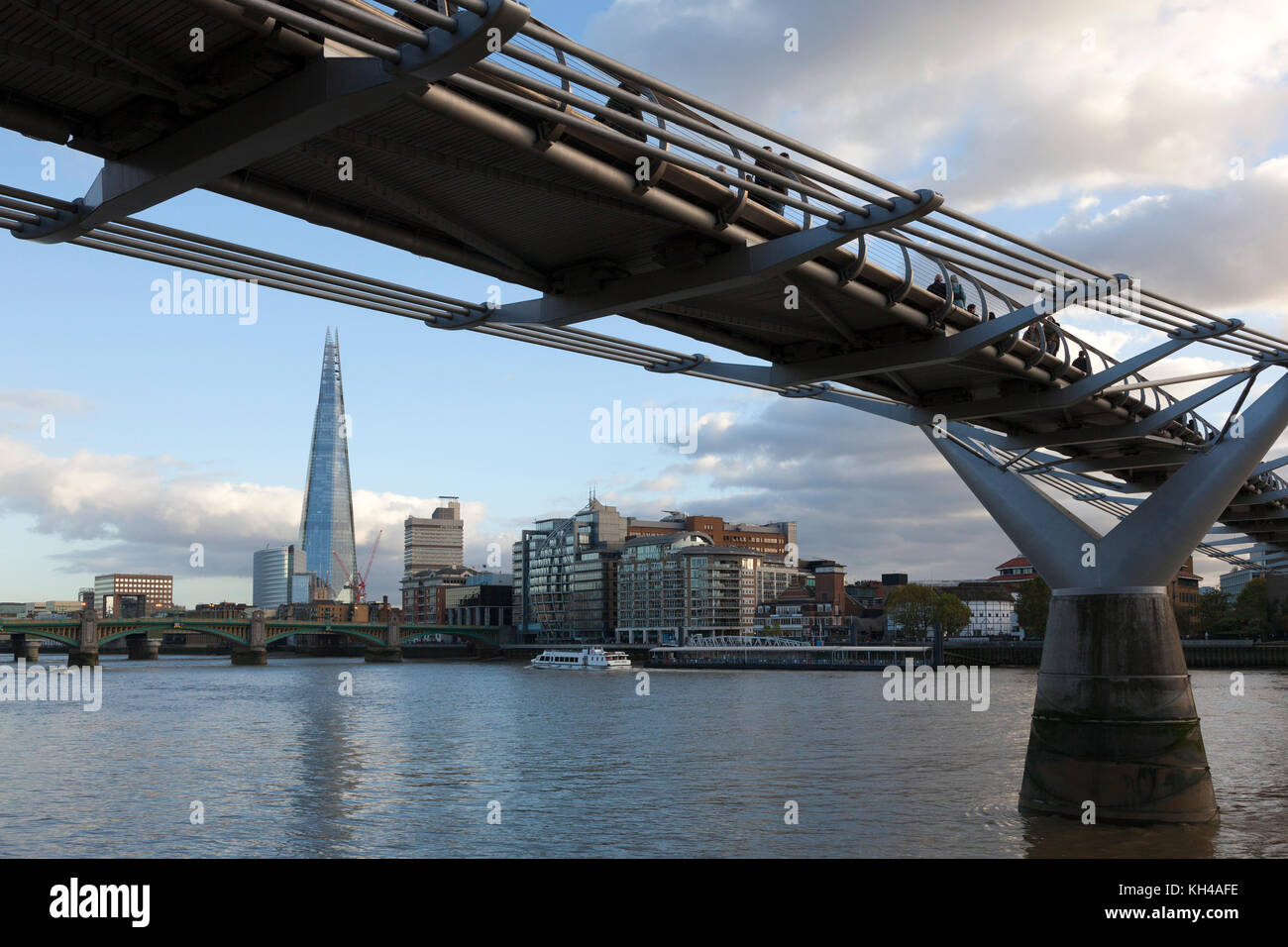Millennium Bridge with The Shard in the distance, London - Stock Image