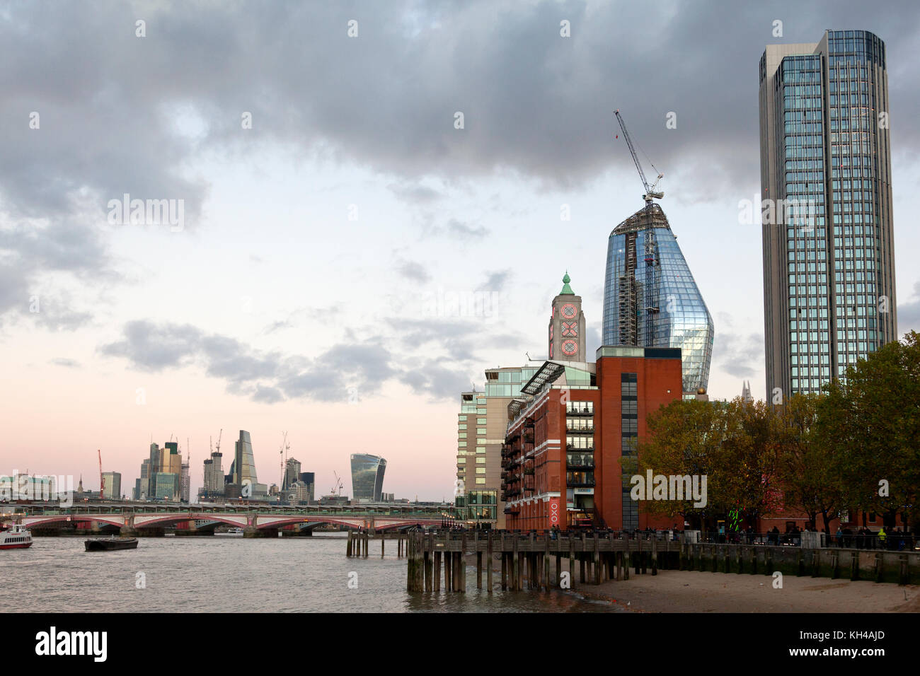 View of Blackfriars Bridge and buildings along the River Thames, London - Stock Image