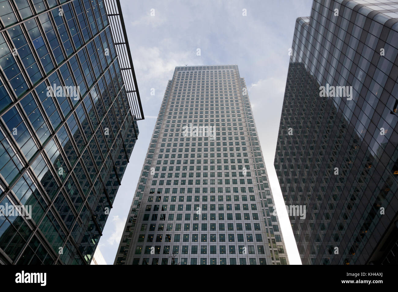Canary Wharf Tower flanked by other blocks, London - Stock Image