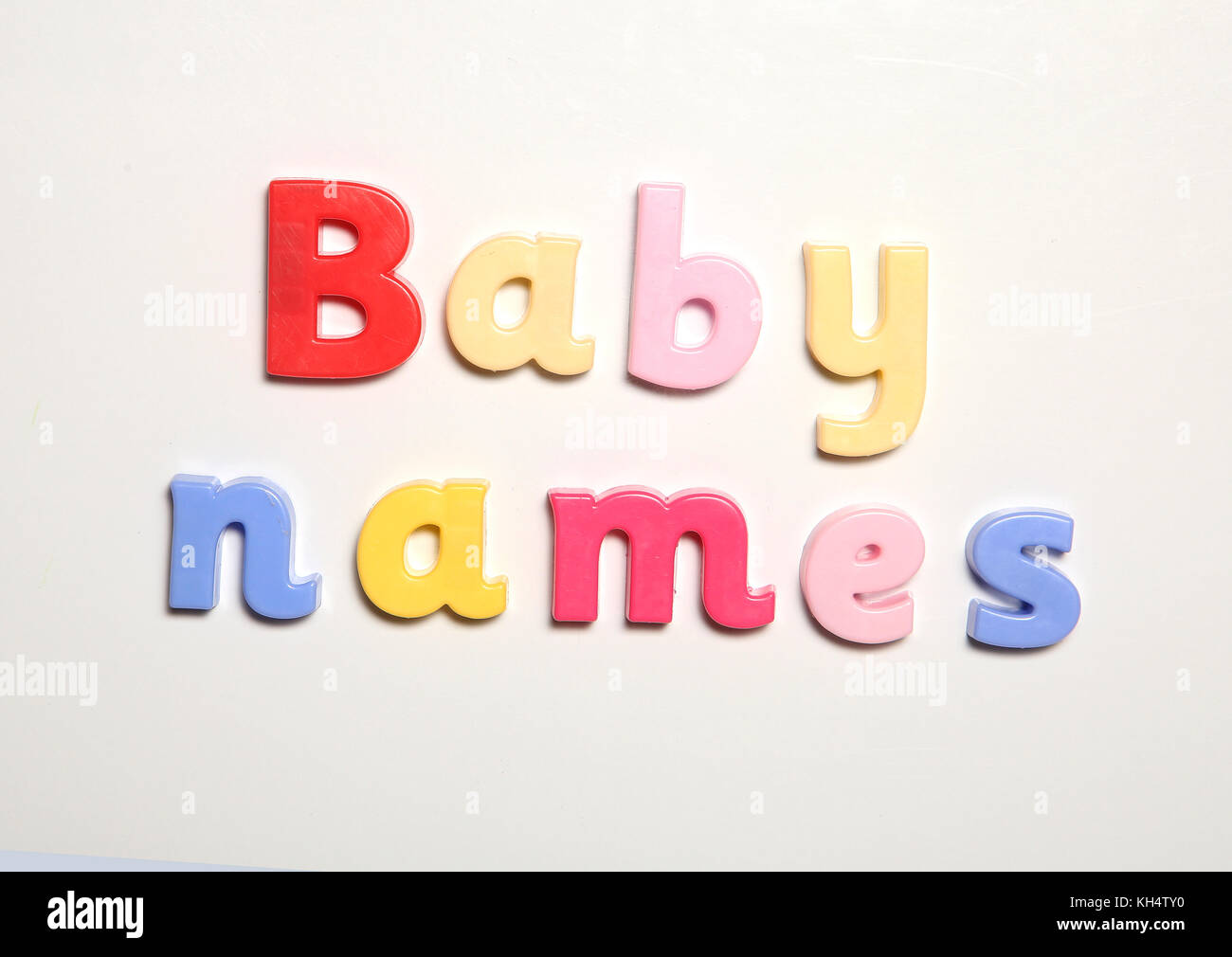 baby names spelt in magnet letters - Stock Image