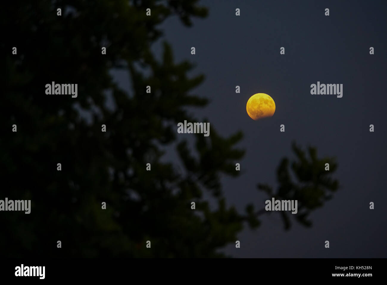 Rising Moon Photographed in Crete, Greece - Stock Image