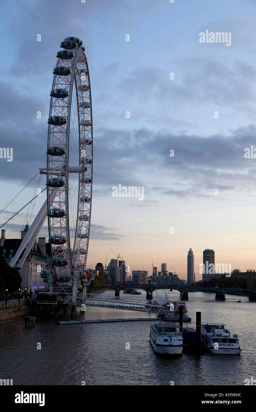 London Eye and view along the Thames at dusk - Stock Image