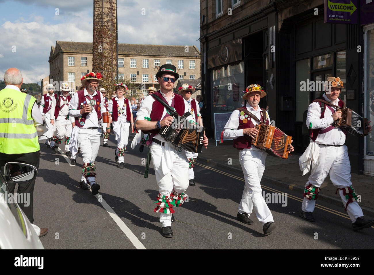 Leeds Morris Men in the procession at the 2017 Sowerby Bridge Rushbearing Festival - Stock Image