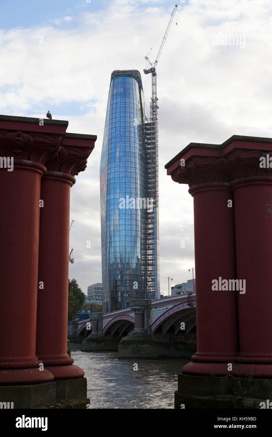 'One Blackfriars' seen between the pillars of the old Blackfriars Bridge, London - Stock Image