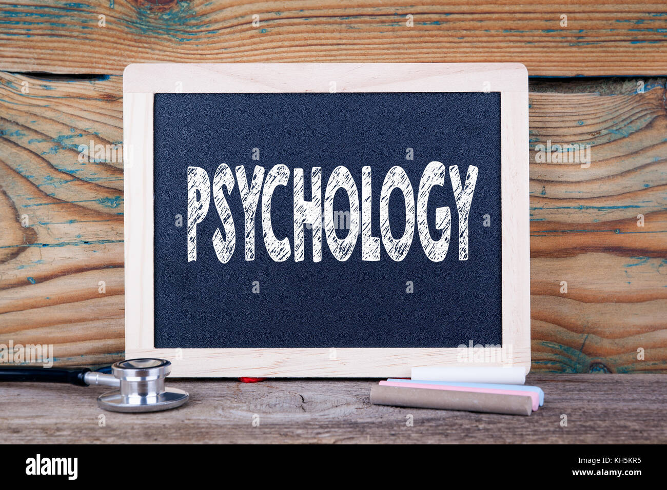 Psychology. Health concept. Chalkboard on a wooden background - Stock Image