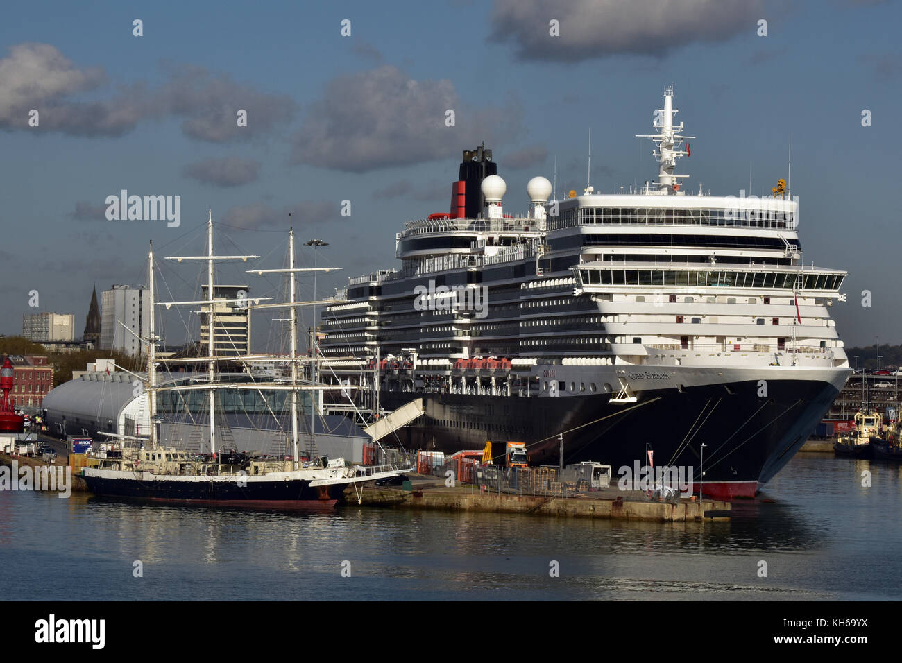 the cunard cruise liner queen Elizabeth in the port of Southampton docks next to a three mast sailing ship of a - Stock Image
