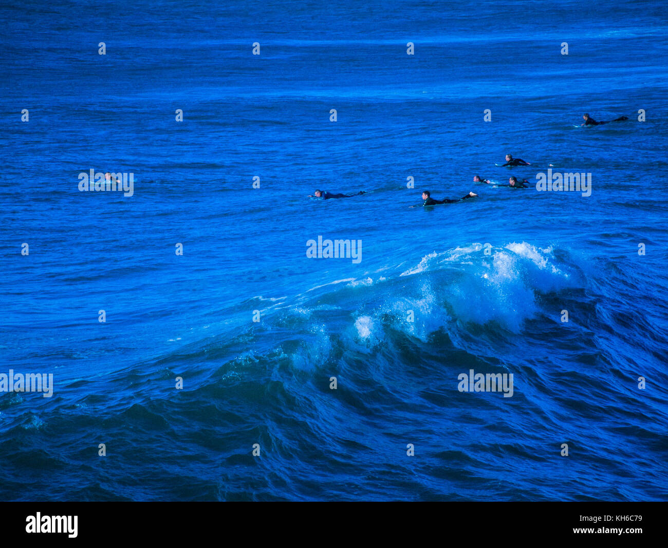 Stylised / treated image of surfers at Newquay in Cornwall. Actually the waves off Fistral Beach. - Stock Image