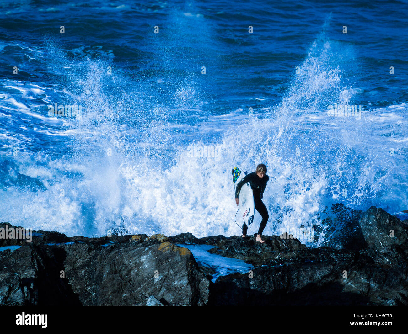 Stylised / treated image of surfer at Newquay in Cornwall. Actually the waves off Fistral Beach. - Stock Image