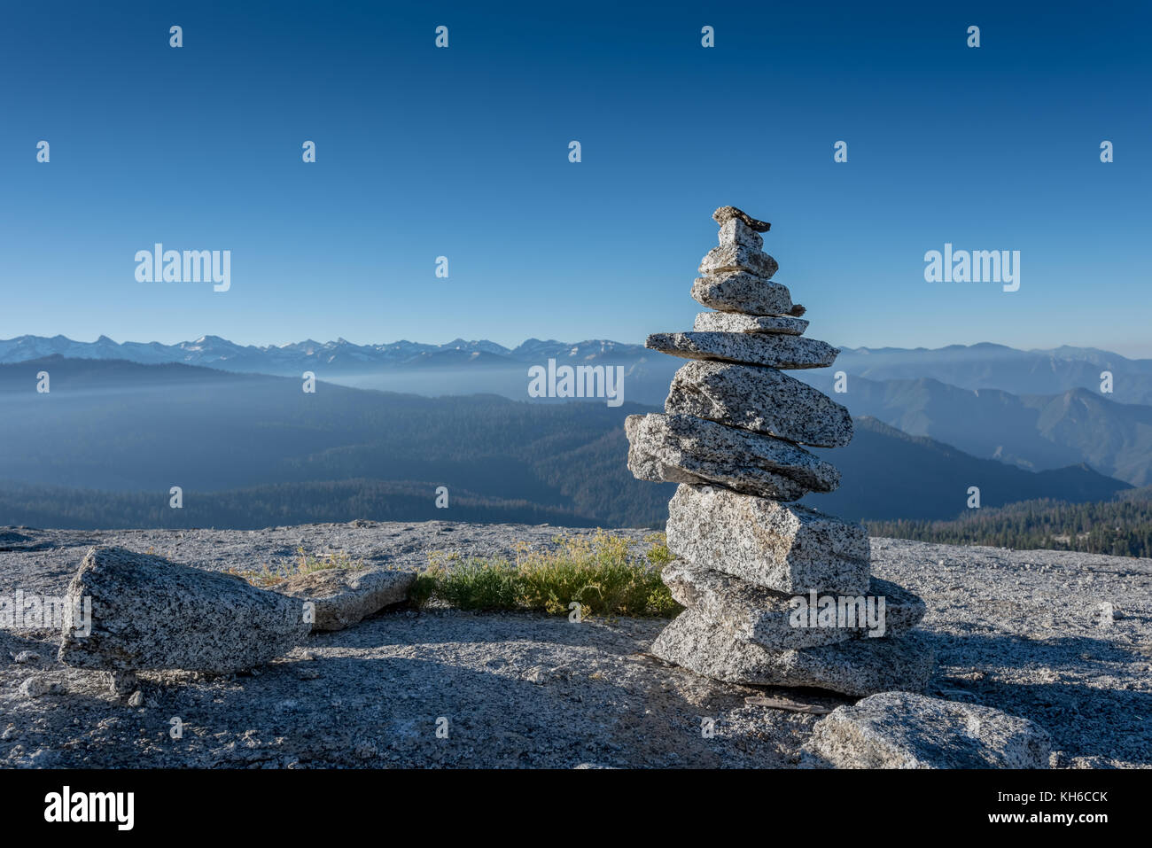 Cairn in Front of High Sierra Mountain Range - Stock Image