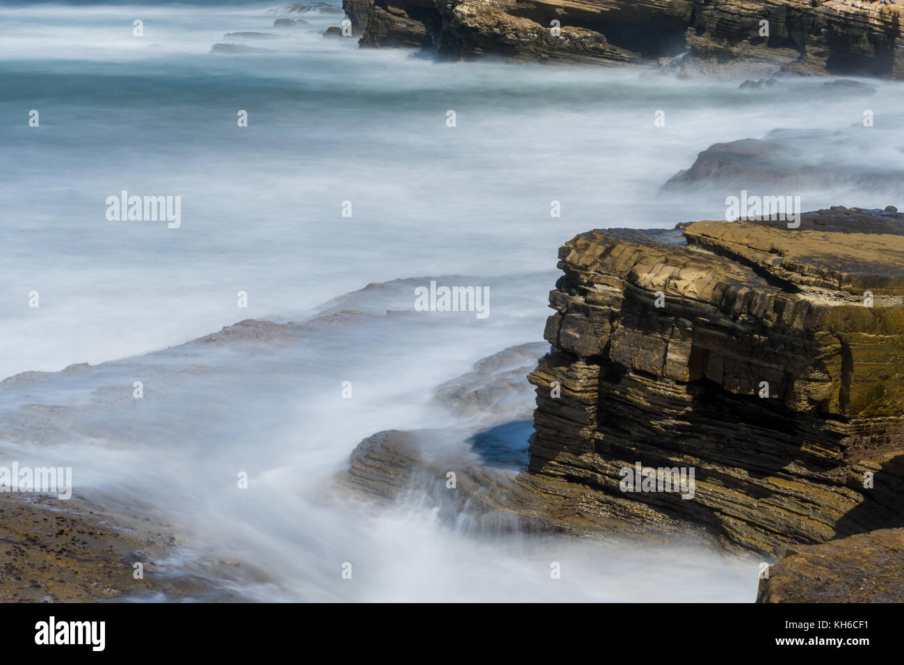 Close Up of Long Exposure of Waves  Along Pacific Coast - Stock Image
