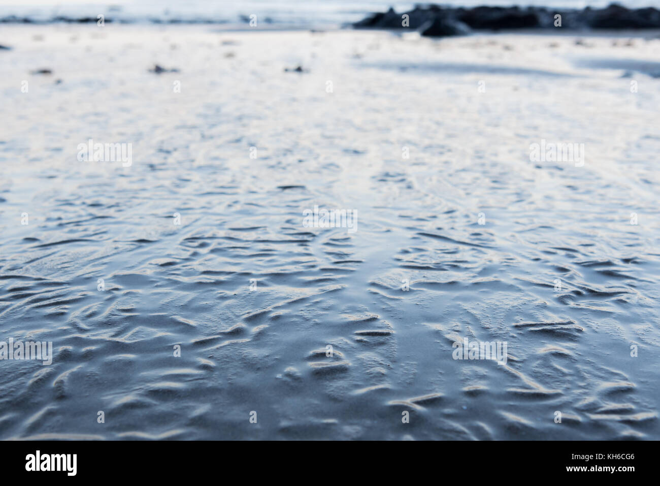 Close up of Wrinkles in Sandy Surface from receding tide - Stock Image