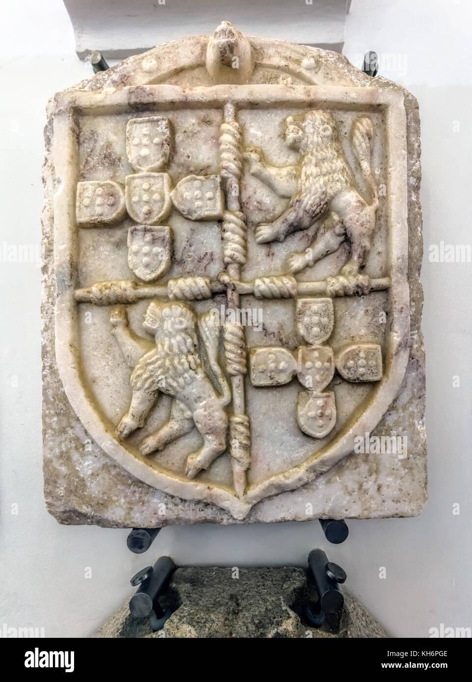 Evora Museum in Evora, Portugal. Marble Coat of Arms of Sousas do Prado, early 16th century. - Stock Image