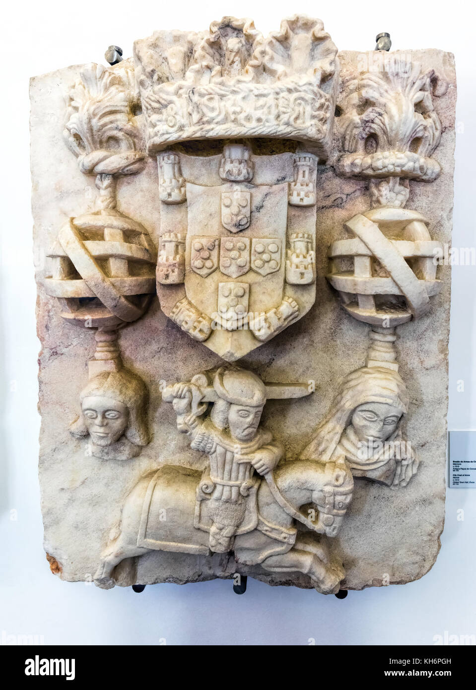 Evora Museum in Evora, Portugal. Marble Coat of Arms of City of Evora, early 16th century. - Stock Image