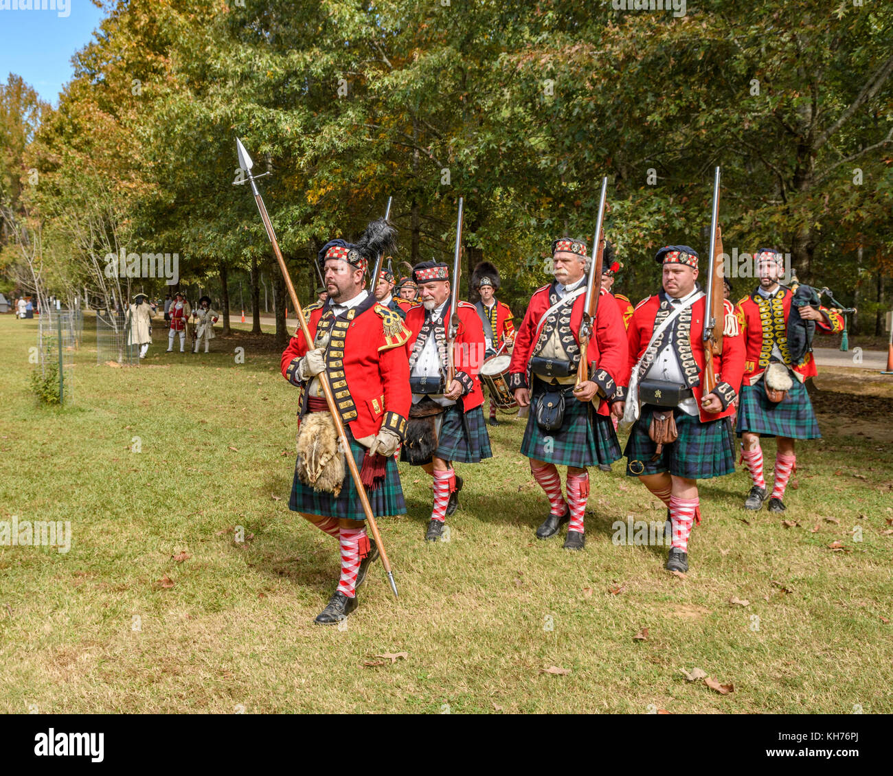 Reenactment actors portraying the 42nd Highlanders Regiment, Black Watch, of the 1700's, drum and pipes. - Stock Image