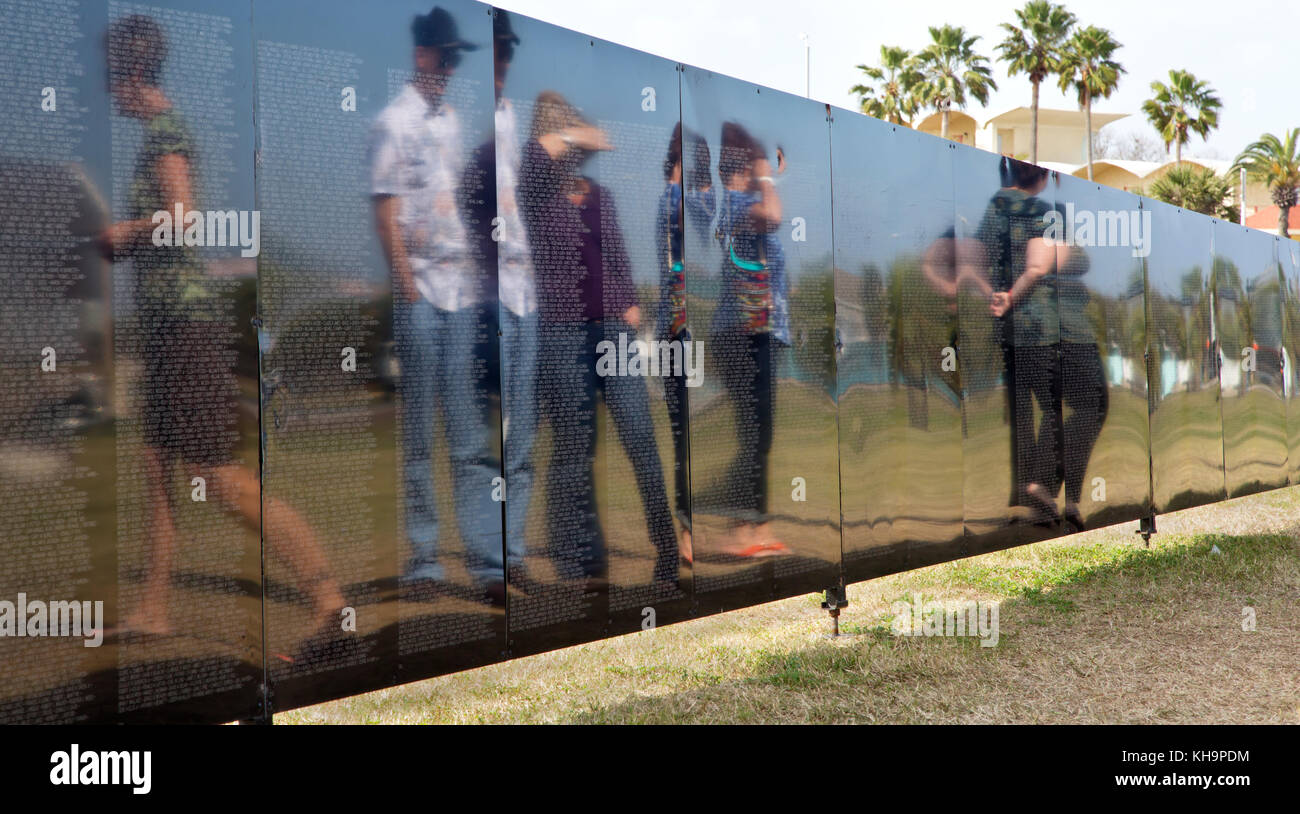 Family members & visitors paying respect to fallen solders, Vietnam Memorial Traveling Wall. - Stock Image
