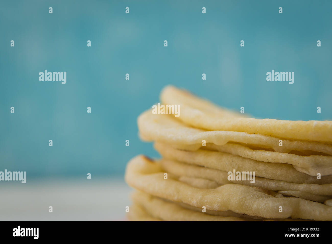 Detail on Homemade Tortillas with copy space over blue background - Stock Image