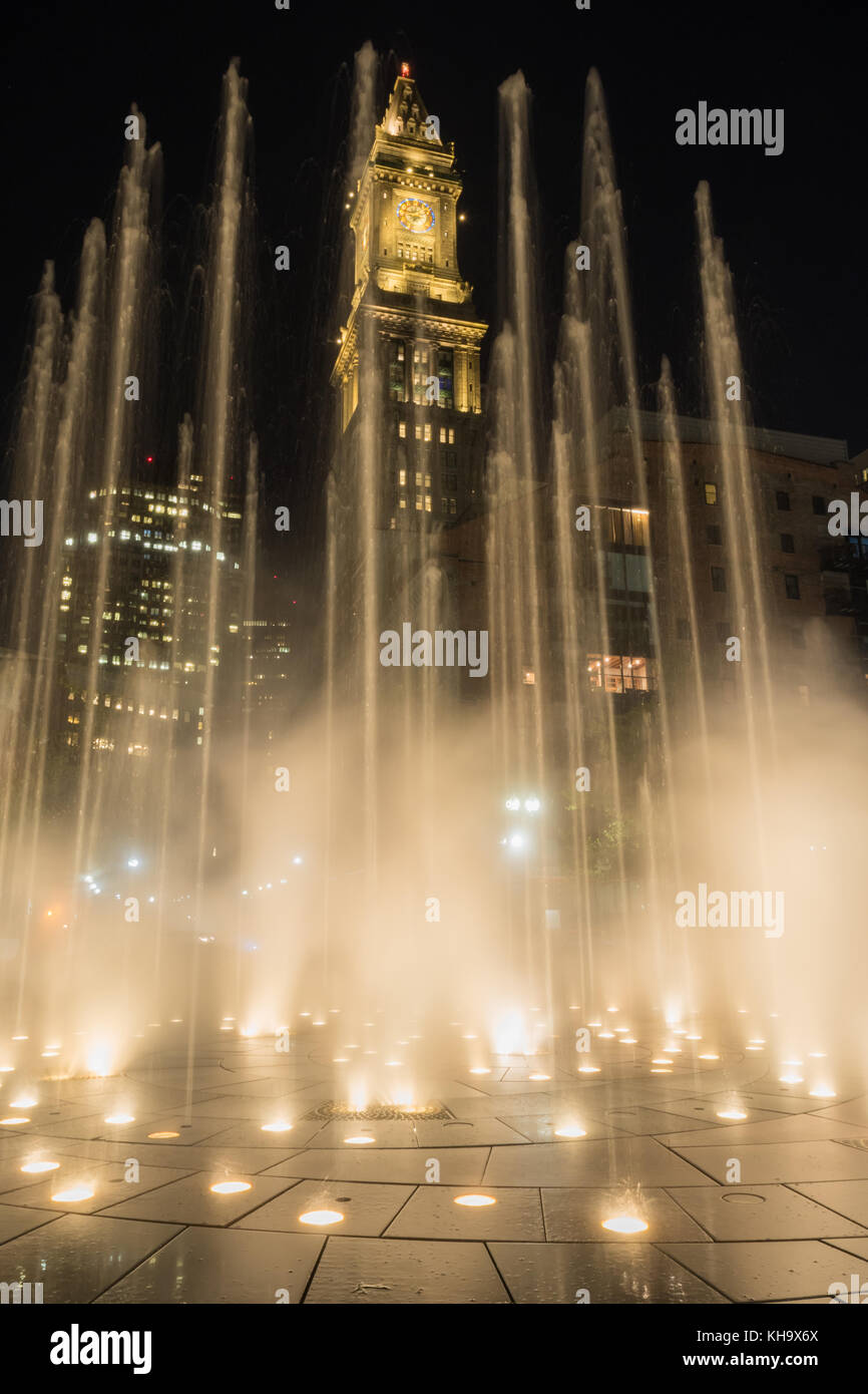 Fountain Blasts Upward as Custom House Tower Looms Behind - Stock Image