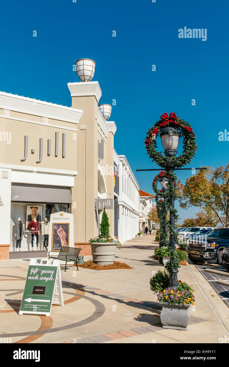 Sidewalk of The Summit shopping center decorated for Christmas holiday season with J-Jill store in background. Birmingham, - Stock Image