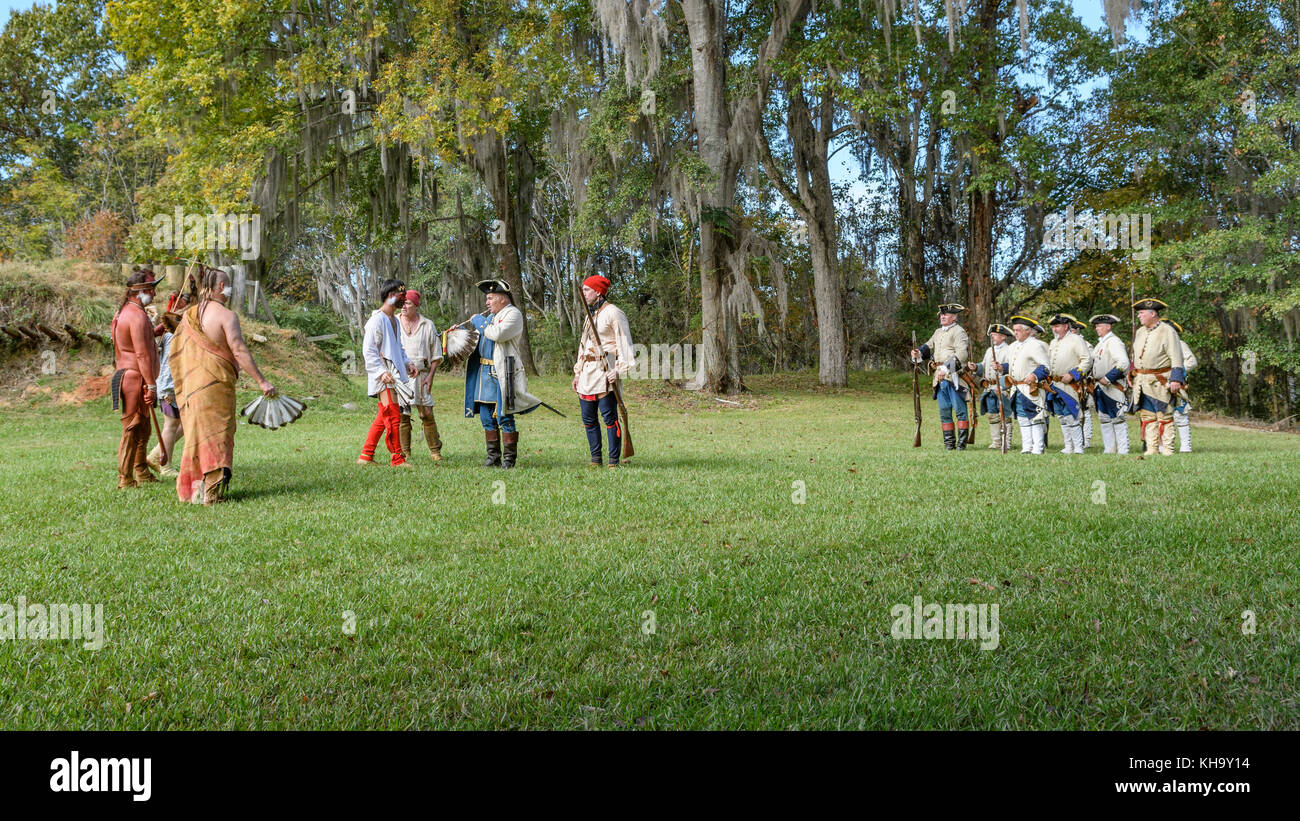 Reenactment of 1700's French soldiers arriving to establish Fort Toulouse, Alabama USA, meeting the native American - Stock Image