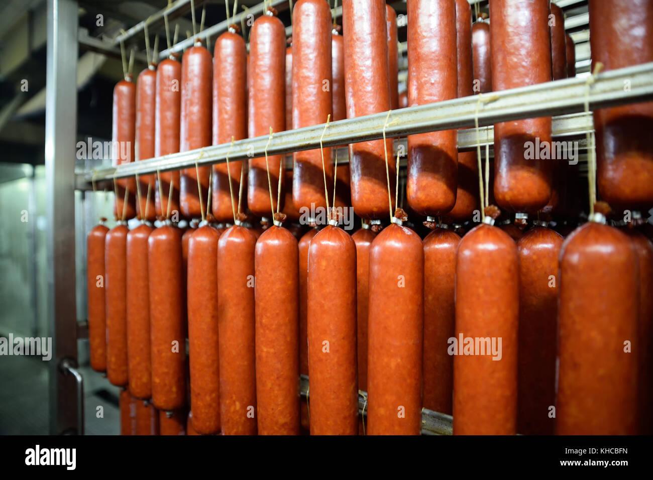 smoked sausage in the smokehouse - Stock Image