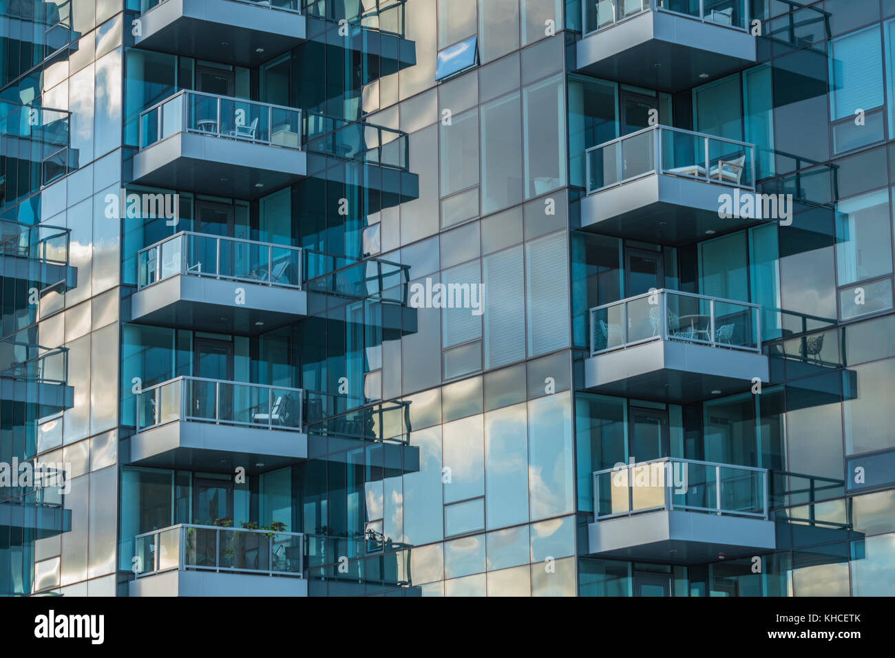 Glass Balconies Reflect Morning Light on modern skyscraper - Stock Image