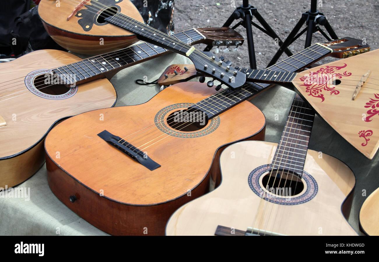 Stringed musical instruments guitar and balalaika - Stock Image