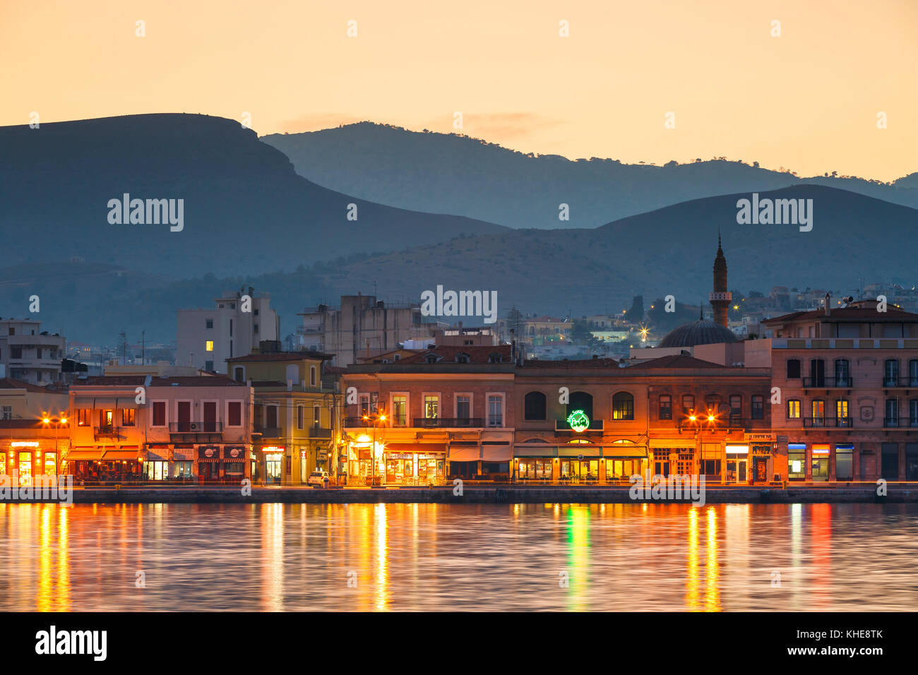 Chios town and its seafront as seen from the pier of the harbour. - Stock Image