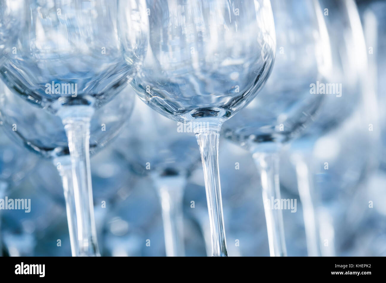Empty wine glasses in a restaurant - Stock Image