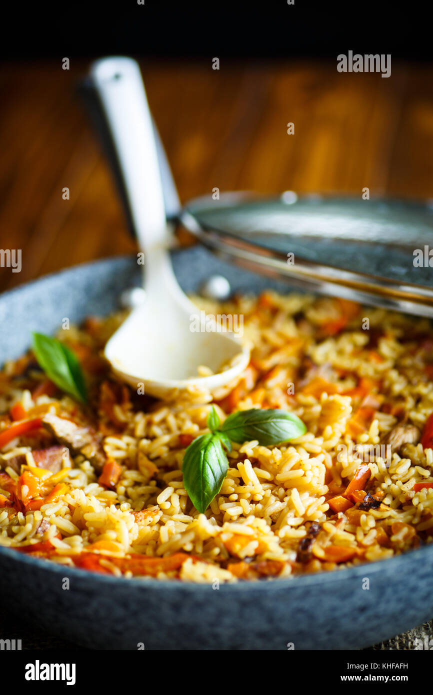 Pilaf with beef, carrots, onions, garlic, pepper and cumin. A traditional dish of Asian cuisine. - Stock Image