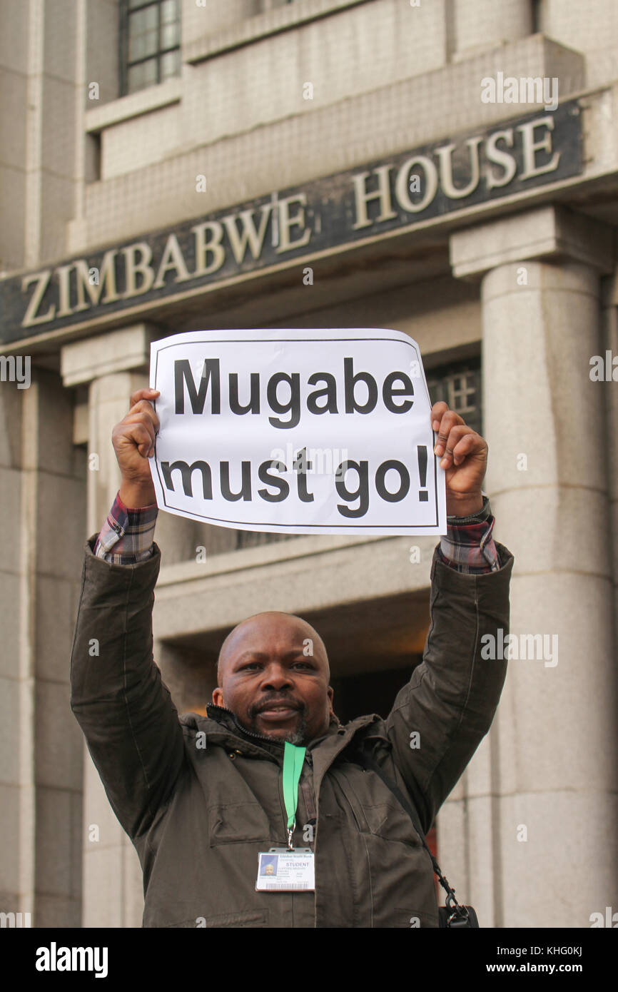 London, UK. 21 February 2015: A demonstrator hold up a placard with the words 'Mugabe must go! outside Zimbabwe - Stock Image