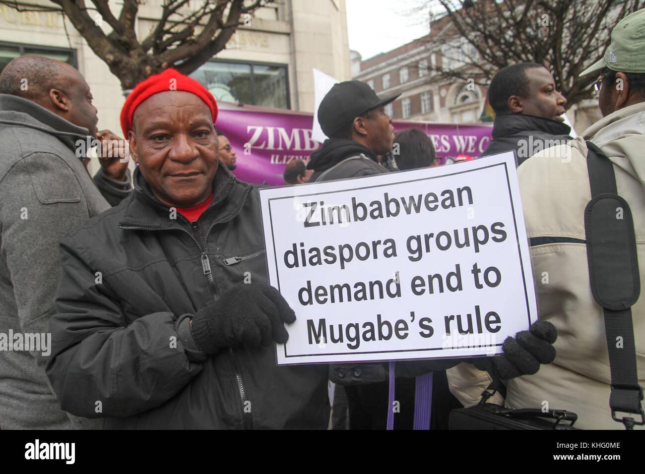London, UK. 21 February 2015: Hundreds of Zimbabwean demonstrators take part in a demonstration outside Zimbabwe - Stock Image
