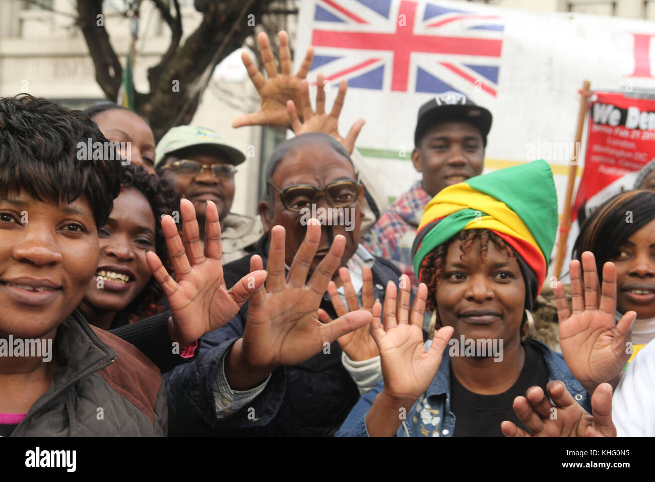 London, UK. 21 February 2015: A protestor with a Mugabe mask takes part in a demonstration outside Zimbabwe House - Stock Image