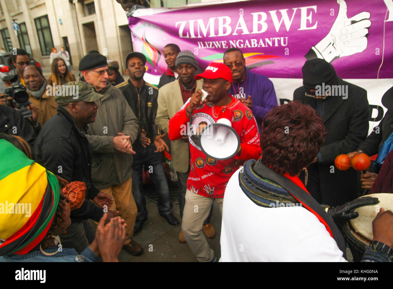 London, UK. 21 February 2015: Hundreds of Zimbabwean demonstrators sing and dance during a demonstration outside - Stock Image