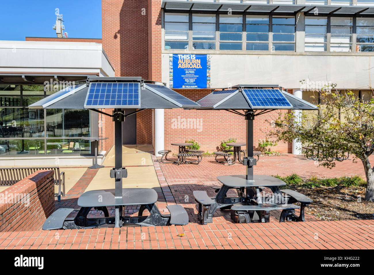 Solar powered computer and cell phone charging stations built into picnic tables at Auburn University, Auburn Alabama - Stock Image