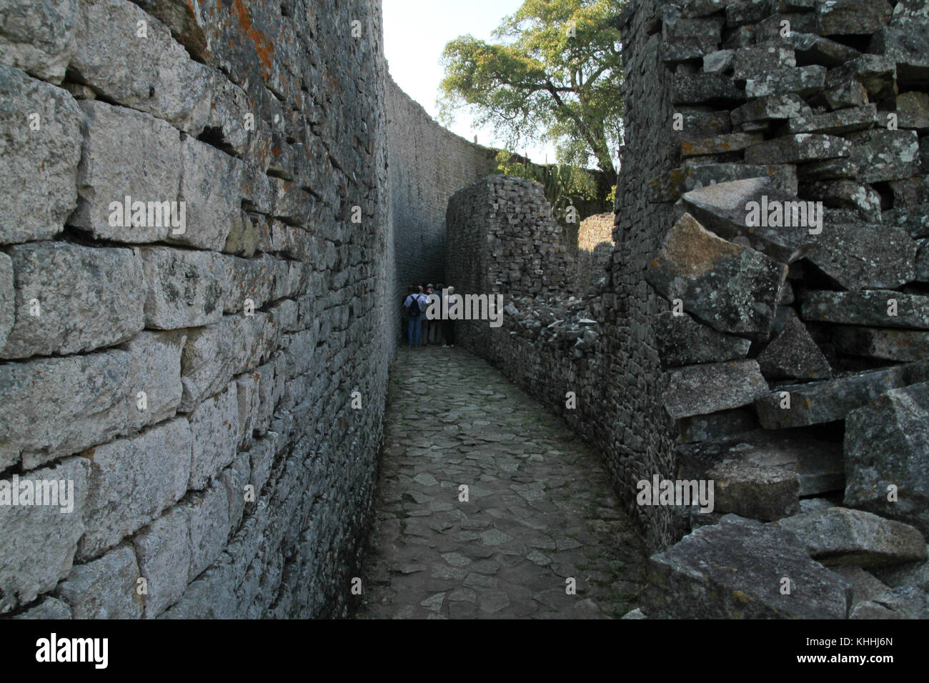 GREAT ZIMBAWE, ZIMBABWE -  16 October 2011: Tourist walk through the narrow path of the Great Enclosure which was - Stock Image