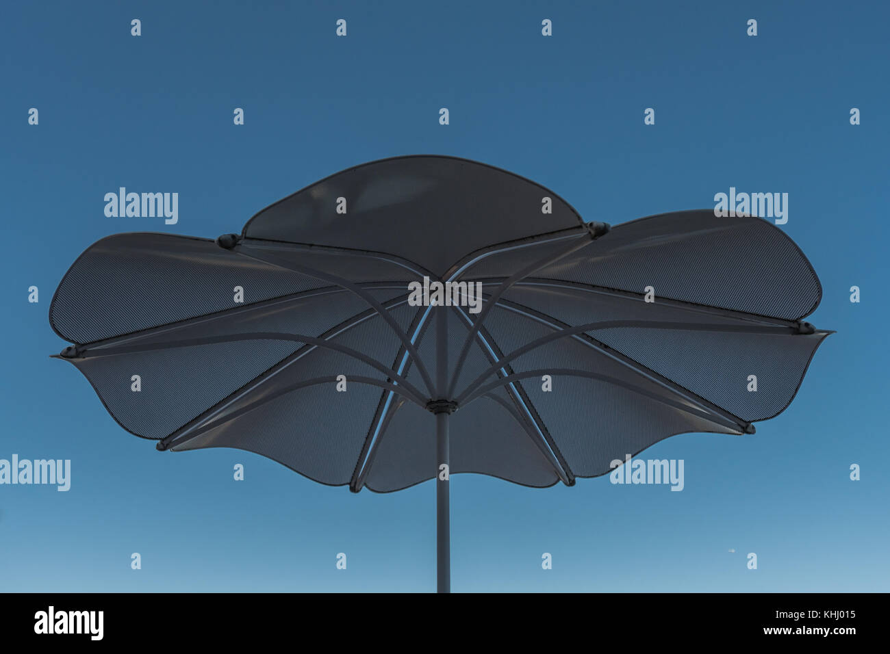 Looking Up into Shade Umbrella and Blue Sky - Stock Image