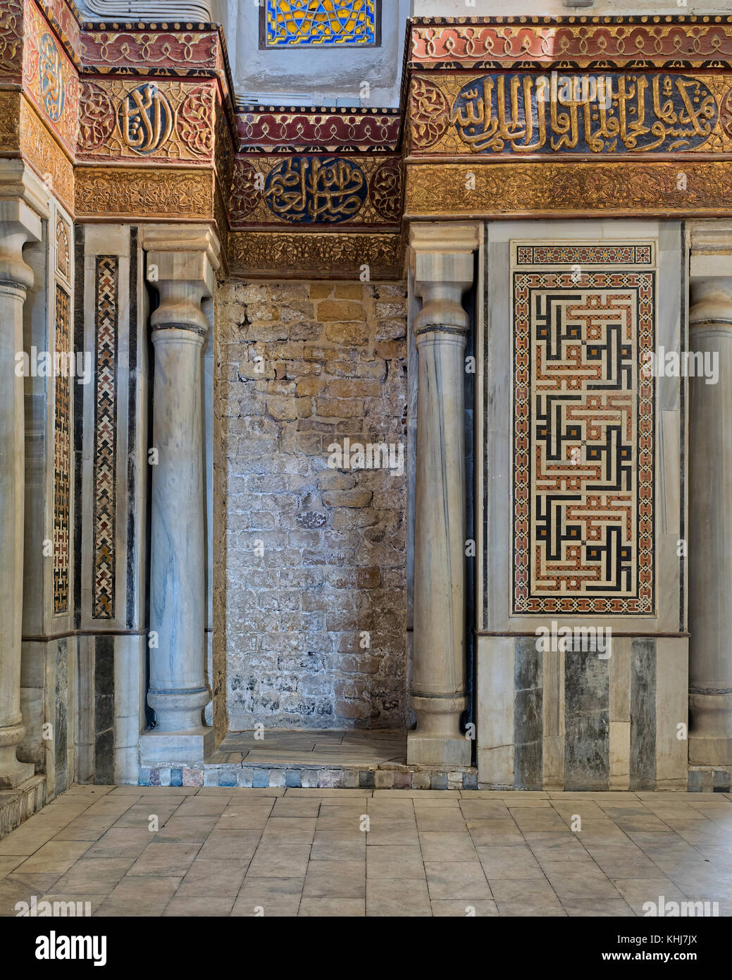 Interior view of decorated marble walls surrounding the cenotaph in the mausoleum of Sultan Qalawun, part of Sultan - Stock Image